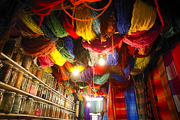 Brightly dyed wool hanging from roof of a shop, Marrakech, Morocco, North Africa, Africa