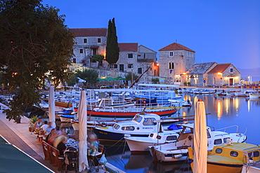 Harbour lit up at dusk, Bol, Brac Island, Dalmatian Coast, Croatia, Europe