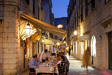 People eating at outdoor restaurant at dusk in the old town, Dubrovnik, Croatia, Europe
