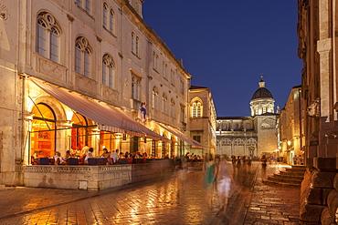 Pred Dvorom, lit up at dusk, cathedral in background, Dubrovnik, Croatia, Europe