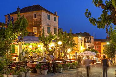 Restaurants at dusk, Makarska, Dalmatian Coast, Croatia, Europe