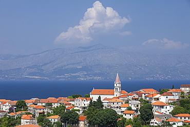 View of town with mainland in background, Postira, Brac Island, Dalmatian Coast, Croatia, Europe