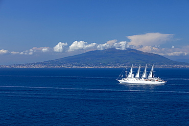 Mount Vesuvius from across the Bay of Naples with Wind Surf cruise ship in foreground, Campania, Italy, Europe
