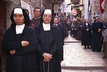 Monks and nuns in a Franciscan procession along the Via Dolorosa, an important street in Christianity, in the Old City of Jerusalem, Israel, Middle East