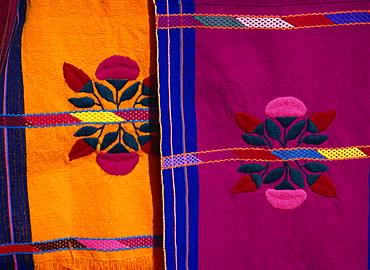 Brightly coloured craft rugs on display at San Cristobal de las Casas, in Chiapas, Mexico, North America - 557-2335