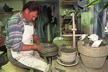 Man working on potter's wheel, ceramics workshop, Corund, Transylvania, Romania, Europe