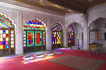 Colourful stained glass in the Maharaja's throne room, Meherangarh Fort Museum, Jodhpur, Rajasthan state, India, Asia