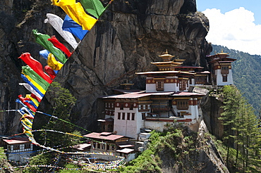 Taktshang Goemba (Tigers nest monastery) with prayer flags and cliff, Paro Valley, Bhutan, Asia