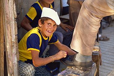 Portrait of a smiling shoeshine boy in downtown Van in Kurdistan, Turkey, Asia Minor, Eurasia