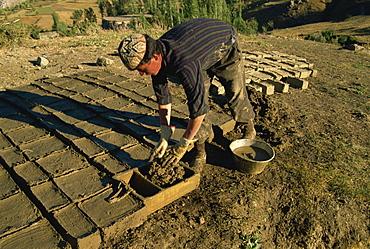 Man making clay bricks for his house, Kurdistan, Anatolia, Turkey, Asia Minor, Eurasia