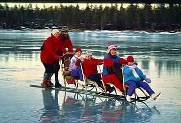 Quattro kick sledge on frozen Norwegian Lake, Norway, Scandinavia, Europe