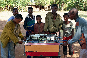 Children playing table football, Bonga Forest, Ethiopia, Africa