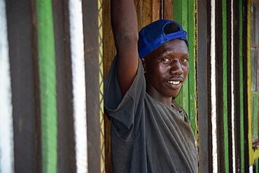 Boy standing in doorway, Meru, Kenya, East Africa, Africa
