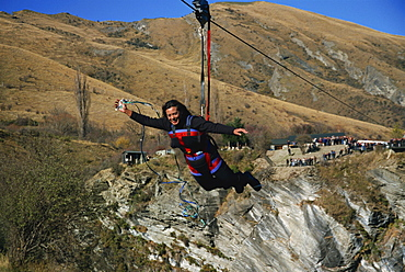 Flying fox, flying on wire over canyon, Queenstown, South Island, New Zealand, Pacific