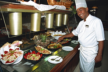 Final touches from chef to seafood buffet, Havana, Cuba, West Indies, Central America