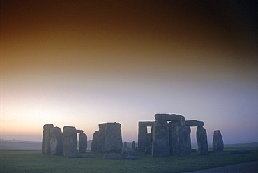 Standing stone circle at sunrise, Stonehenge, Wiltshire, England, UK, Europe