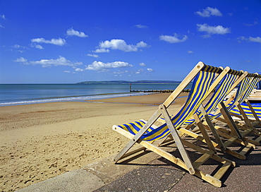 Deckchairs on the Promenade overlooking deserted beach, West Cliff, Bournemouth, Dorset, England, United Kingdom, Europe