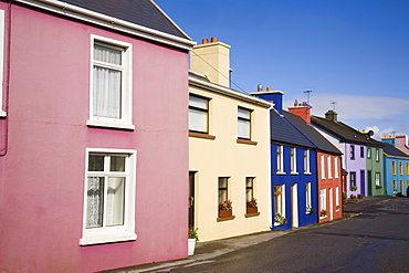 Row of colourful traditional houses in main street of historical village on Ring of Beara tourist route, Eyeries, Beara Peninsula, County Cork, Munster, Republic of Ireland, Europe