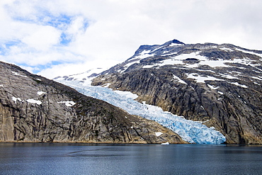 Head of a glacier calving into Prince Christian Sound (Prins Christians Sund) in summer, Kujalleq, Greenland, Polar Regions