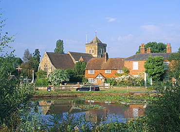 St. Mary's church, cottages and village sign, Chiddingfold, Haslemere, Surrey, England, United Kingdom, Europe