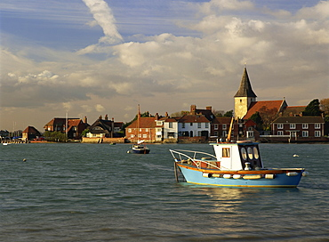 View across water at high tide, Bosham village and harbour, Sussex, England, United Kingdom, Europe