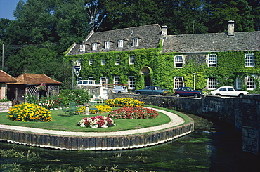 Swan Hotel on a bend in the River Coln, Bibury, Gloucestershire, The Cotswolds, England, United Kingdom, Europe