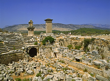 The theatre, with Lycean tombs in the background, Xanthos, UNESCO World Heritage Site, Anatolia, Turkey, Asia Minor, Eurasia