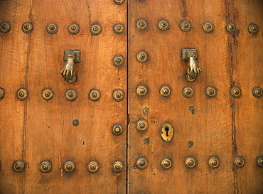 Detail of old door with hand of Fatima doorknockers, Ronda, Andalucia, Spain, Europe