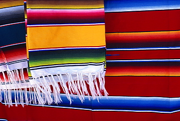 Striped woven rugs in vibrant primary colours for sale in Mexico, North America