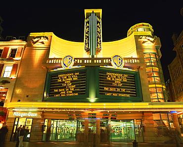 Exterior of the Warner Cinema illuminated at night, Leicester Square, London, England, United Kingdom, Europe