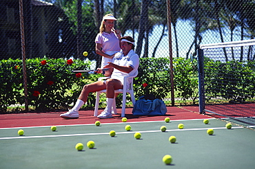 Tennis court with couple