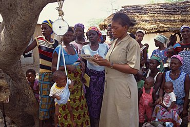 Weighing baby, Garinkuka Outreach aid project, Ghana, West Africa, Africa