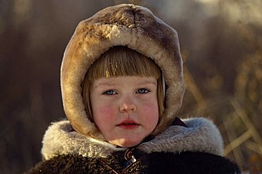 Head and shoulders portrait of young Russian girl wearing a fur hat, looking at the camera, Moscow, Russia, Europe