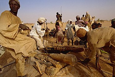 People at well during famine in 1997, Darfur, Sudan, Africa