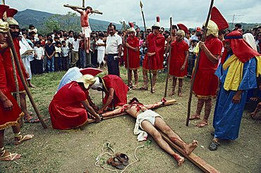 Men in Roman costume and men on crosses during a crucifixion re-enactment at Easter in Ciudad Santos, Mexico, North America