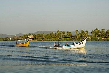 Tourist boats on backwater near Mobor, Goa, India
