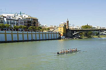 Puente de Isabel II, also known as Puente de Triana, with Triana district on left and the river Rio Guadalquivir, Seville, Andalusia, Spain, Europe
