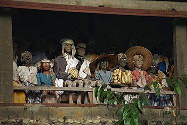 Effigies of the dead, Lemo cliff tombs, Toraja area, island of Sulawesi, Indonesia, Southeast Asia, Asia