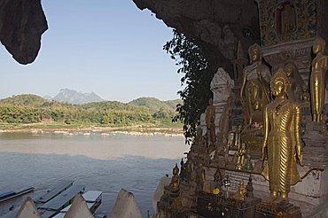 Buddhas in Pak Ou caves, Mekong River near Luang Prabang, Laos, Indochina, Southeast Asia, Asia