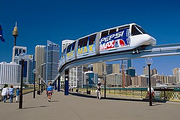 The Monorail at Darling Harbour with the city skyline beyond, Sydney, NSW, Australia