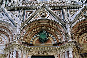 Gothic detail on the facade of the Duomo (Cathedral), including the sun symbol, Siena, UNESCO World Heritage Site, Tuscany, Italy, Europe