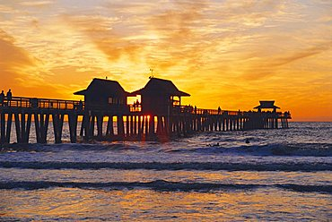 Naples, Florida, USA. People gathered on the pier at sunset