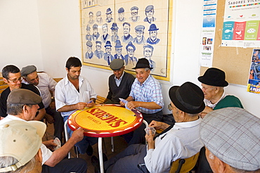 Local men play cards at Aljezur, Algarve, Portugal, Europe