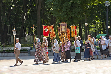 A Russian Orthodox Group encircle Parliament performing a ceremony to cast out evil, Mariins'kyi Park, Kiev, Ukraine, Europe