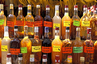 Bottles of local rum drinks at Le Diamant village, Martinique, West Indies, Caribbean, Central America