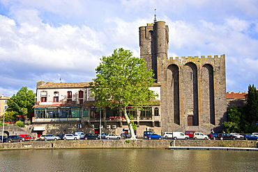 The fortified St. Etienne cathedral built of black lava and dating from the 12th century, and Herault river, Agde town, Haut Languedoc, France, Europe