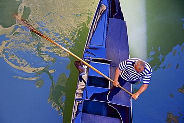 Gondolier on his gondola, Venice, UNESCO World Heritage Site, Veneto, Italy, Europe - 665-5410
