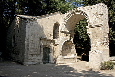 Arch of the 12th century Saint Cesaire Abbey, Alyscamps, gallo-roman necropolis, Arles, Bouches du Rhone, Provence, France, Europe