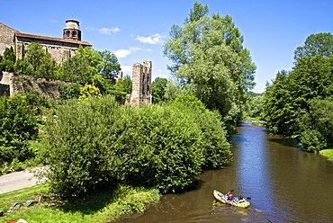 Ruins and Benedictine abbey tower, along the Senouire river, and canoeing, at Lavaudieu, a medieval village, Auvergne, Haute Loire, France, Europe