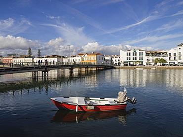 Boat and Pedestrian Bridge, River Gilao,Tavira, Algarve, Portugal, Europe
